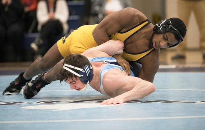 Moorestown's Ronald McCoy, top, controls Highland's Emidio Mariani during the 145 lb. bout of the South Jersey Group 4 semifinal wrestling match held at Highland High School on Wednesday, February 12, 2020.   McCoy defeated Mariani, 12-2.