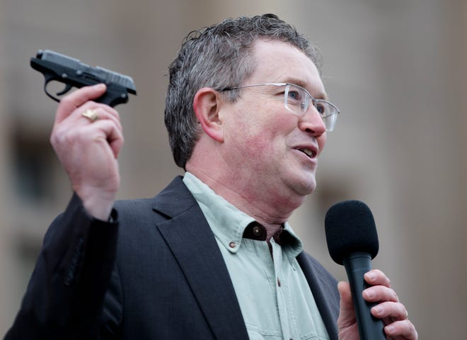 U.S. Rep. Thomas Massie holds up his Ruger LCP while speaking at a second amendment rally outside the Kentucky State Capitol building in Frankfort, Ky. on Friday. Jan. 31, 2020.