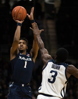 Xavier Musketeers guard Paul Scruggs (1) shoots over Butler Bulldogs guard Kamar Baldwin (3) in the first half of the NCAA men's basketball game between Xavier Musketeers and Butler Bulldogs on Wednesday, Feb. 12, 2020, at Hinkle Fieldhouse in Indianapolis, Ind.