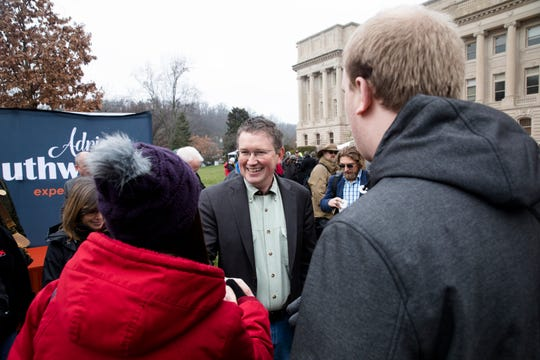 U.S. Rep. Thomas Massie speaks to people at a second amendment rally outside the Kentucky State Capitol building in Frankfort, Ky. on Friday. Jan. 31, 2020.