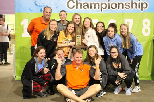 Ryle girls swimming with their Region 7 team championship trophy, Feb. 8, 2020.