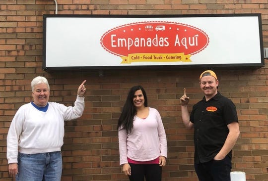 From left, Pat Fettig, Dadni Johnson and Brett Johnson, the owners of Empanadas Aqui Cafe