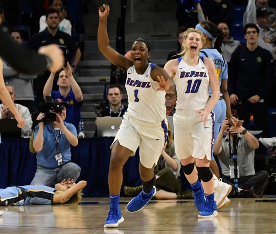 Mar 12, 2019; Chicago, IL, USA; DePaul Blue Demons guard Ashton Millender (1) and guard Lexi Held (10) celebrate their win against the Marquette Golden Eagles in the women's Big East Conference Tournament at Wintrust Arena. Mandatory Credit: David Banks-USA TODAY Sports