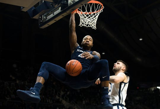 Xavier Musketeers forward Tyrique Jones (4) dunks over Butler Bulldogs forward Bryce Golden (33) in the first half of the NCAA men's basketball game between Xavier Musketeers and Butler Bulldogs on Wednesday, Feb. 12, 2020, at Hinkle Fieldhouse in Indianapolis, Ind.