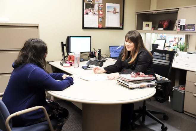 Fourth-year college student Cristaliz Portalatin (left) seeks FAFSA guidance from Brittany De La Rosa, regional director of financial aid at Miami University Regionals.