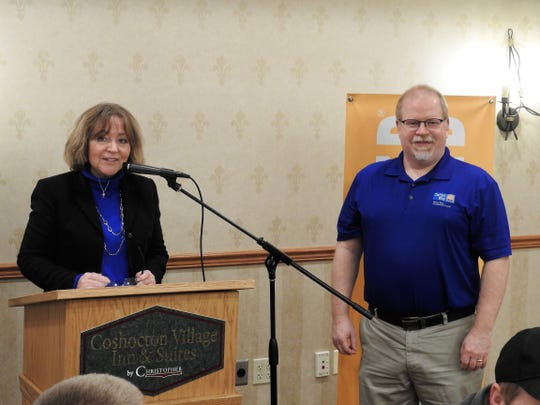 Lyn Mizer, executive director of the United Way of Coshocton County, recognizes Tom Heading for his time as local board president. The annual United Way breakfast on Thursday honored partner agencies and donors. The chapter has exceeded its campaign goal of $325,000.