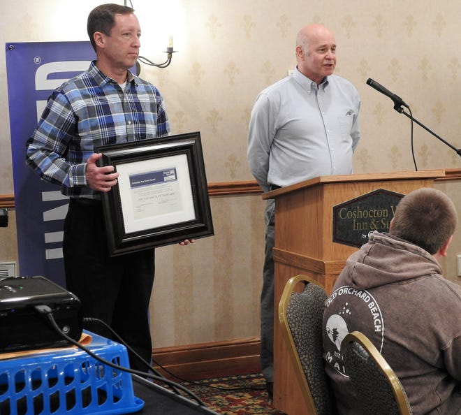 Scott Muhleman and Jerry Sturtz of AK Steel accepts the top donor award for the past campaign season at the annual breakfast for the United Way of Coshocton County. The company donated $51,000.