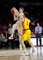 Feb 12, 2020; Norman, Oklahoma, USA; Oklahoma Sooners guard Austin Reaves (12) goes to the basket as Iowa State Cyclones guard Caleb Grill (2) defends during the first half at Lloyd Noble Center. Mandatory Credit: Alonzo Adams-USA TODAY Sports