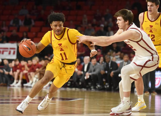 Iowa State guard Prentiss Nixon (11) drives past Oklahoma guard Austin Reaves (12) during the first half of an NCAA college basketball game in Norman, Okla., Wednesday, Feb. 12, 2020. (AP Photo/Kyle Phillips)