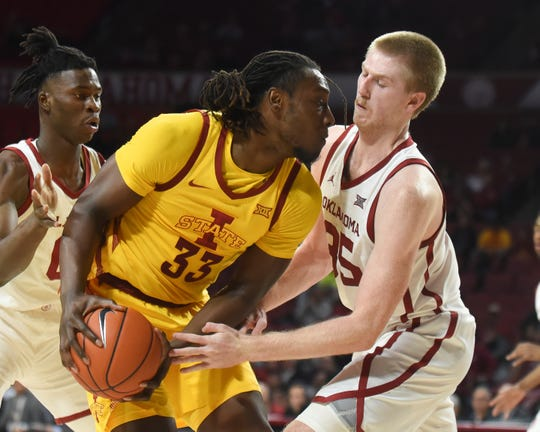 Oklahoma forward Brasy Manek (35) tries to steal the ball from Iowa State forward Solomon Young (33) during the first half of an NCAA college basketball game in Norman, Okla., Wednesday, Feb. 12, 2020. (AP Photo/Kyle Phillips)