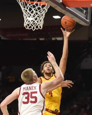Iowa State forward George Conditt IV (4) shoots in front of Oklahoma forward Brady Manek (35) during the first half of an NCAA college basketball game in Norman, Okla., Wednesday, Feb. 12, 2020. (AP Photo/Kyle Phillips)