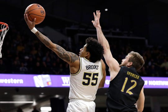 Michigan guard Eli Brooks shoots past Northwestern guard Pat Spencer during the first half in Evanston, Ill., Wednesday, Feb. 12, 2020.