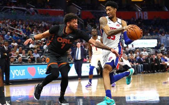 Detroit Pistons forward Christian Wood drives to the basket vs. Orlando Magic guard Michael Carter-Williams during the first half Wednesday, Feb. 12, 2020 in Orlando.