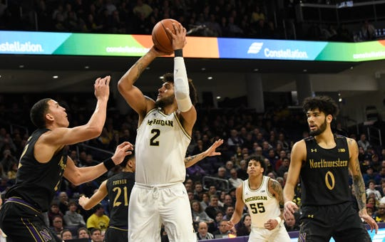 Michigan forward Isaiah Livers shoots over Northwestern forward Pete Nance during the first half in Evanston, Ill., Feb. 12, 2020.