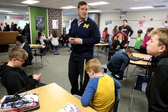 After his presentation former Michigan football player Will Heininger talks with seventh grade students at Mill Creek Middle School in Dexter, Michigan on Thursday, January 30, 2020.