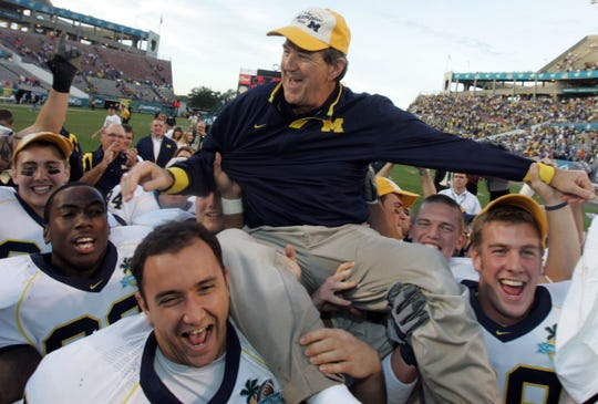 Michigan football player Will Heininger, right wearing a hat is all smiles as he and teammates carry off their head coach, Lloyd Carr, after their Citrus Bowl game against the University of Florida at the Capital One Bowl in Orlando, Florida on January 1, 2008. Michigan won the bowl game 41-35. Heininger, was dealing with pressure and bouts of depression during this time and now teaches around the country to middle and high schoolers the warning signs and what to do about them.