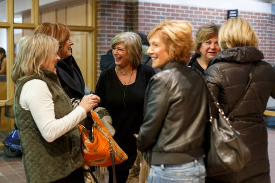 Friends from left, Lisa Ciaravino, Geri Kuclo, Barb DeGrandchamp, Sandy Balone, Cheryl Fudge and Darlene Tuladziecki catch up while they meet at the Rochester Hills Public Library on Sunday, February 9, 2020 in Rochester Hills.