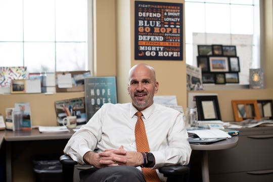 Tim Schoonveld, Director of Athletics of Hope College in Holland poses for a photo in his office, Wednesday, Feb. 11, 2020.
