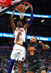Detroit Pistons forward Christian Wood dunks over Orlando Magic guard Evan Fournier during the first half Wednesday, Feb. 12, 2020 in Orlando. s
