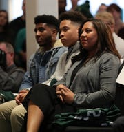 Jo-Ellyn Tucker and sons Christian and Joseph listen as Mel Tucker is introduced as the new Michigan State football coach Wednesday, Feb. 12, 2020 at the Breslin Center in East Lansing.