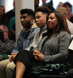 Jo-Ellyn Tucker and sons Christian and Joseph listen as Mel Tucker is introduced as the new Michigan State football coach.