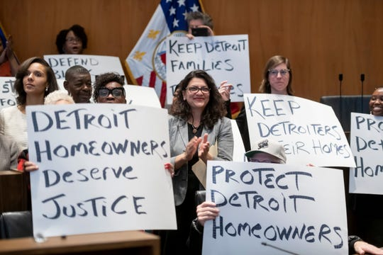 U.S. Congresswoman Rashida Tlaib, center, attends a press conference at the Coleman A. Young Municipal Center, in Detroit, February 13, 2020, to announce a class action lawsuit against the city for the over assessment of home values for thousands of home owners.