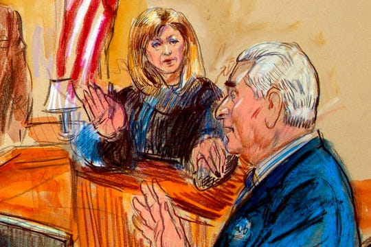 This courtroom sketch shows former campaign adviser for President Donald Trump, Roger Stone talking from the witness stand as Judge Amy Berman Jackson listens during a court hearing at the U.S. District Courthouse in Washington, Thursday, Feb. 21, 2019. Berman Jackson issued a broad gag order forbidding Stone to discuss his criminal case with anyone and gave him a stinging reprimand over his posting of a photo of the judge with what appeared to be crosshairs of a gun.