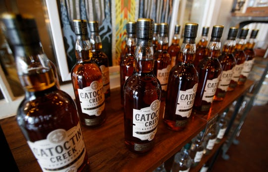 FILE - In this June 20, 2018 file photo, Catoctin Creek Distillery whiskey is on display in a tasting room in Purcellville, Va. A new spirits industry report says President Donald Trump's trade war dampened the overseas market for American-made whiskey last year.