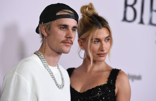 "Justin Bieber and Hailey Baldwin arrive at the Los Angeles premiere of ""Justin Bieber: Seasons,"" Monday, Jan. 27, 2020."