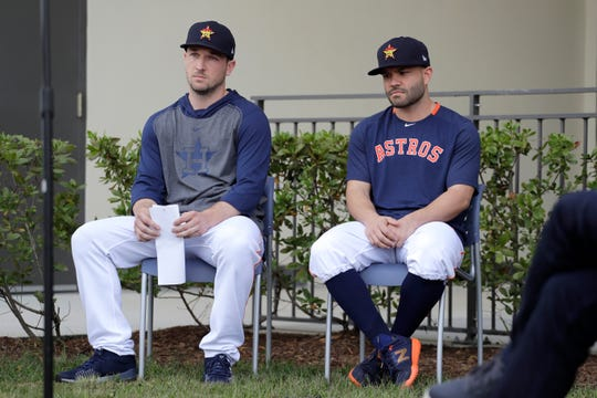 Houston Astros infielder Alex Bregman, left, and teammate Jose Altuve sit in chairs as the wait to deliver statements during a news conference Thursday before the start of the first official spring training practice in West Palm Beach, Florida.