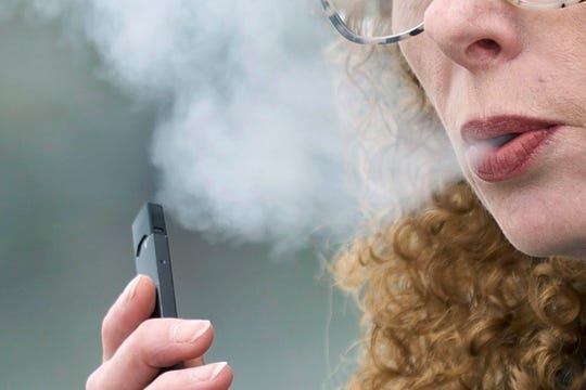 """Attorney General Maura Healey's office said the nation's biggest e-cigarette maker is responsible for """"creating a youth vaping epidemic"""" with deceptive advertising tactics designed to lure in teen users."""
