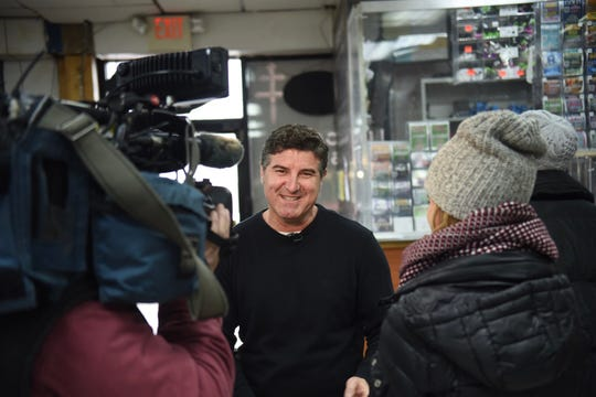 Yousef Anton, owner of Huron Liquor Plaza, speaks to local media on Thursday, February 13, 2020 about selling the $70 million Powerball ticket from his Pontiac store.