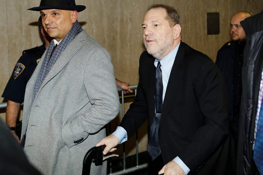 Harvey Weinstein, right, leaves his rape trial, Tuesday in New York.