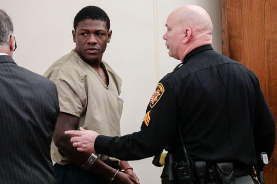 Former Ohio State football player Jahsen Wint, center, looks back to his attorney, Sam Shamansky, left, following his arraignment on Thursday, Feb. 13, 2020, at the Franklin County Municipal Courthouse in Columbus, Ohio.