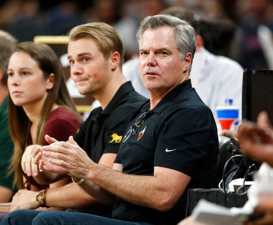 MGM Resorts International chairman Jim Murren watches the first half of a WNBA basketball game in this Aug. 1, 2018, file photo in Las Vegas.
