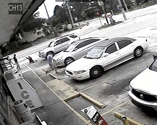 In this Thursday, July 19, 2018 file image taken from surveillance video released by the Pinellas County Sheriff's Office, Markeis McGlockton, far left, is shot by Michael Drejka during an altercation in the parking lot of a convenience store in Clearwater, Fla.