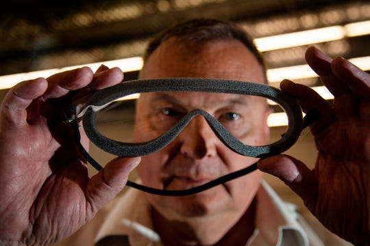 Roy Paulson holds up medical goggles that his company makes for shipment to China to help prevent the spread of the coronavirus on Feb. 7, 2020 in Temecula, Calif.