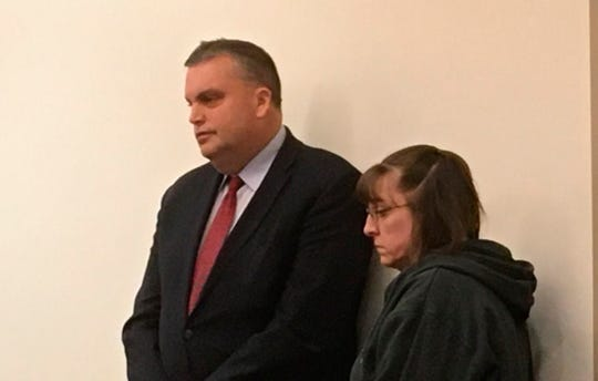 Shelly Hueckel, right, appears in court Tuesday in Grand Rapids,  for sentencing on an assault and battery charge. Heuckel, who used racial slurs as she attacked a black car salesman at a western Michigan dealership, avoided a jail sentence despite a tearful appeal from the victim for time behind bars.  She was sentenced Tuesday to two years of probation by Judge Paul Sullivan.