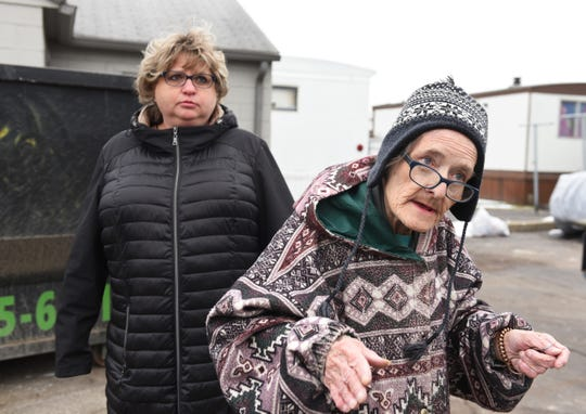 Mary Eahrow, foreground, talks about the deteriorating conditions at the mobile homes park. In the background is Eahrow's caregiver, Kim Blackstone.