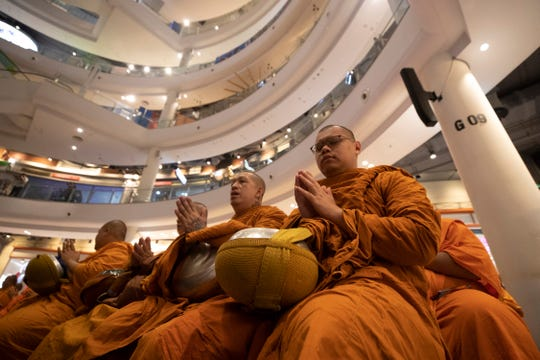 Buddhist monks pray during a ceremony to reopen the Terminal 21 shopping mall in Nakhon Ratchasima, Thailand, Thursday.