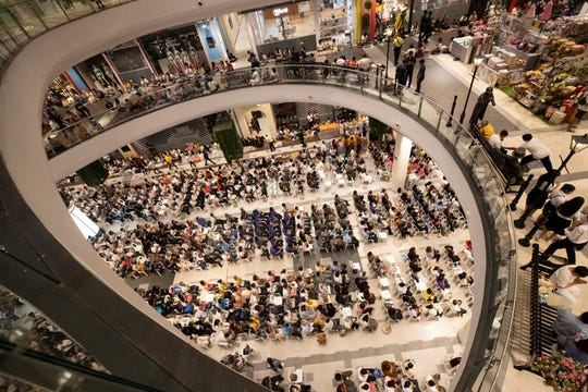 People pray during a ceremony to reopen the Terminal 21 shopping mall in Nakhon Ratchasima, Thailand, Thursday.