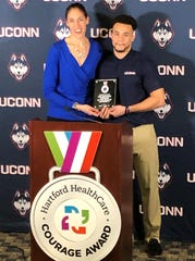 Former UConn and WNBA star Rebecca Lobo presents UConn senior Eli Thomas with the Hartford HealthCare Connecticut Courage Award on Feb. 12, 2020.