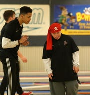 Elmira High School Unified Bowling partner Jeff Wilson, left, works with athlete Alex Ramirez during a meet against Corning on Oct. 12, 2020 at Dixie Lanes in Southport.