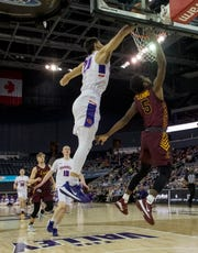 Evansville's Sam Cunliffe (20) blocks Loyola's Keith Clemons (5) shot during the first half of the University of Evansville Purple Aces vs Loyola University Chicago Ramblers game at Ford Center in Evansville, Ind., Wednesday evening, Feb. 12, 2020.