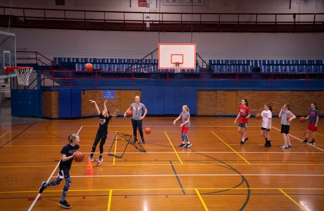 Mitch Lewis, owner and president of Ambition Basketball, runs his girls 12U team through drills at the old Downtown YMCA Wednesday night.
