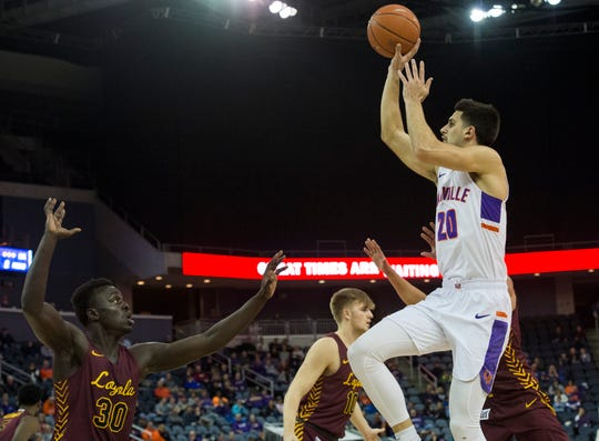 Evansville's Sam Cunliffe (20) takes a shot during the first half of the University of Evansville Purple Aces vs Loyola University Chicago Ramblers game at Ford Center in Evansville, Ind., Wednesday evening, Feb. 12, 2020.