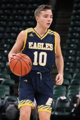 Day School freshman Tyler Myers dribbles the ball during the Eagles game against Eminence at Bankers Life Fieldhouse.