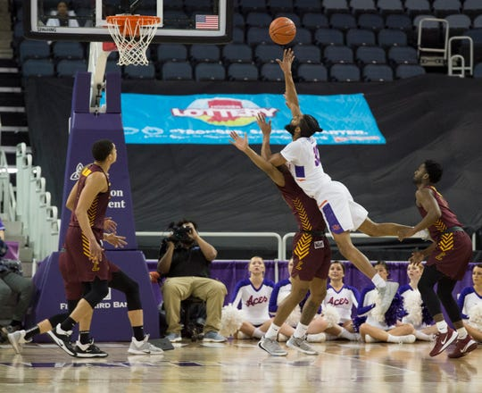 Evansville's K.J. Riley (33) shots over Loyola's Jalon Pipkins (50) during the first half of the University of Evansville Purple Aces vs Loyola University Chicago Ramblers game at Ford Center in Evansville, Ind., Wednesday evening, Feb. 12, 2020.