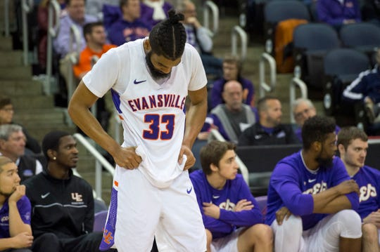 Evansville's K.J. Riley (33) looks toward the court as the time runs out during their game against the Loyola University Chicago Ramblers at Ford Center Wednesday night, Feb. 12, 2020.