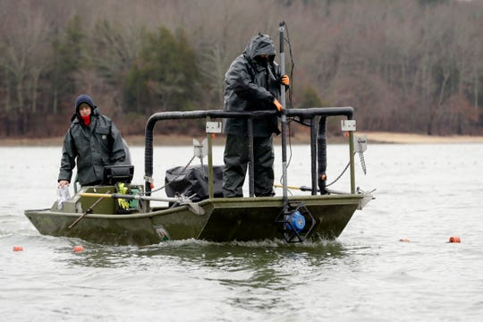 In this Feb. 5 photo, wildlife officials use pulses of electricity and sound to herd schools of Asian carp toward nets during a roundup in Smith Bay on Kentucky Lake near Golden Pond, Ky.  (AP Photo/Mark Humphrey)